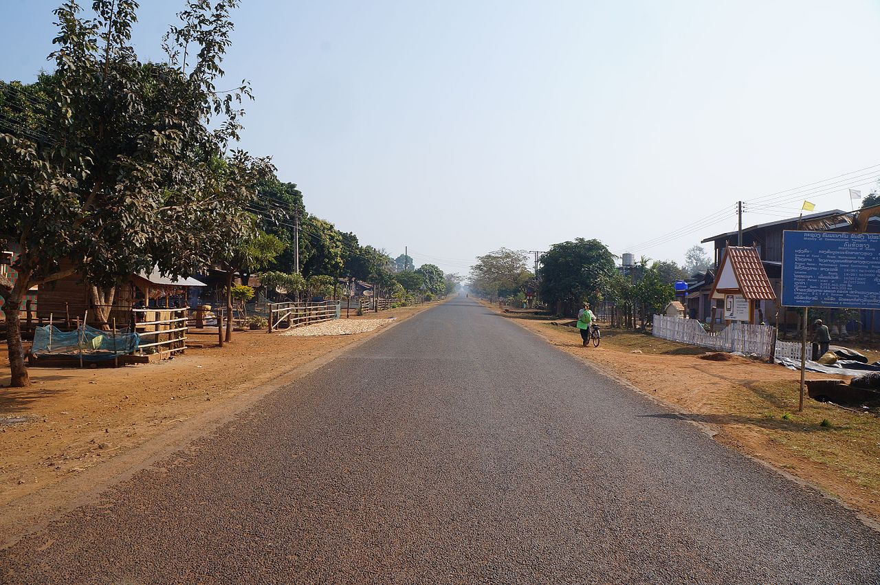 Road in the Bolaven Plateau area, Champasak province, southern Laos. Photo by Pierre Andre, Wikimedia Commons. Licensed under CC-BY-SA 4.0.