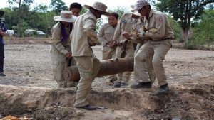 UXO operations team removing a large bomb